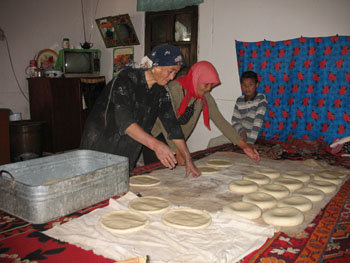 Baking nan is one of the main forms of female cooperation in Uighur villages (September 2006)