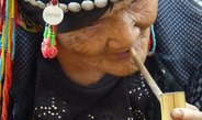 <p>An Akha woman in her eighties smoking a bamboo pipe. She is a respected and loved grandmother and mother to 11 children. The Akha are highlanders, scattered across the Ailao Mountains between the Mekong River and the Red River, and comprise a total population of 680,000.<br /><br />Photo: Ruijing Wang, Menglian, China, 2012<br />Max Planck Institute for Social Anthropology</p>
