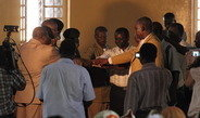 "<p>In celebration of the translation of the Old Testament's ""Book of Nehemiah"" into the Moro language, Nuba Moro Church leaders of representative denominations and clans bless the just-­published text. The image illustrates how the social organisation of the Moro ethnic group is transformed into Church hierarchies.<br /><br />Photo: Siri Lamoureaux, Khartoum, Sudan, 2012<br />Max Planck Institute for Social Anthropology</p>"