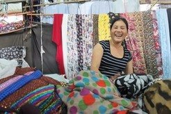 Selling fabric at the market. Esther Horat, 2012