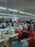 Workers in a family owned sport clothing factory in Shishi, China.