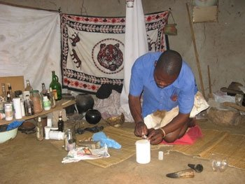 A sangoma prepares muti (medicine) after treating his patient of sidliso (an affliction sent by an alleged witch) Swaziland.