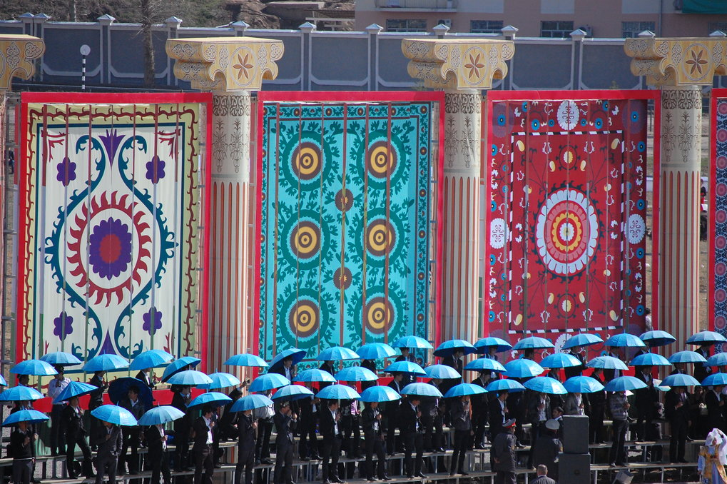 <p>State celebrations of <em>Navruz</em>, the Persian New Year. The central ceremony was held at the hippodrome in the presence of the Tajik president. Students of local universities standing in front of images of traditional <em>suzanies</em>, embroidered fabrics with patterns characteristic for various regions.<br /><br />Photo: Małgorzata Biczyk, Dushanbe, Tajikistan, 2011<br />Max Planck Institute for Social Anthropology</p>