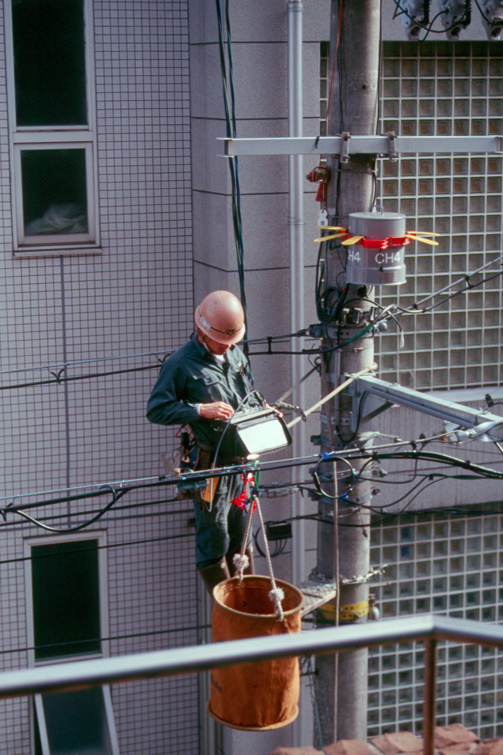 <p>Supply lines getting serviced in Kyoto. As in other Japanese cities, transformers and a dense maze of wires are suspended above the streets rather than placed on the sidewalks for the lack of space.<br /><br />Photo: Christoph Brumann, Kyoto, Japan, 2011<br />Max Planck Institute for Social Anthropology</p>