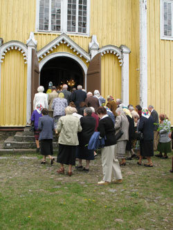 People entering church after procession. Whit Sunday. 2008.
