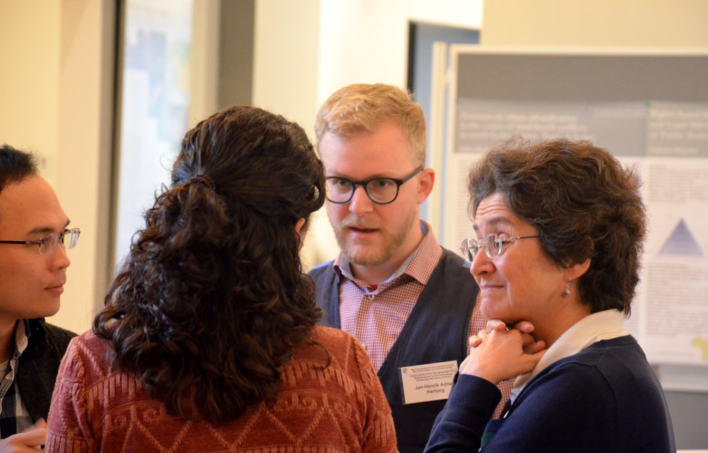 Ph.D. students in conversation with a member of the Principal Faculty