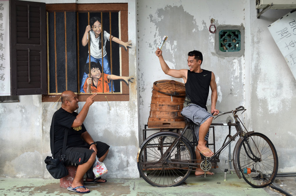 <p>Since 2012, Penang's Street Art is one of the main attractions for young tourists in George Town. Its affordance-character invites the visitor to become part of the art. Following this request the two backpackers Erfino from Indonesia and Tony from California join the picture.<br /><br />Photo: Mareike Pampus, George Town, Penang, Malaysia, 2015<br />Max Planck Institute for Social Anthropology</p>