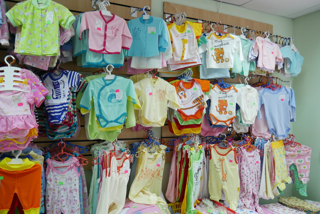 A baby clothes firm managed by a married couple; in addition to manufacturing, the business includes a small retail chain.