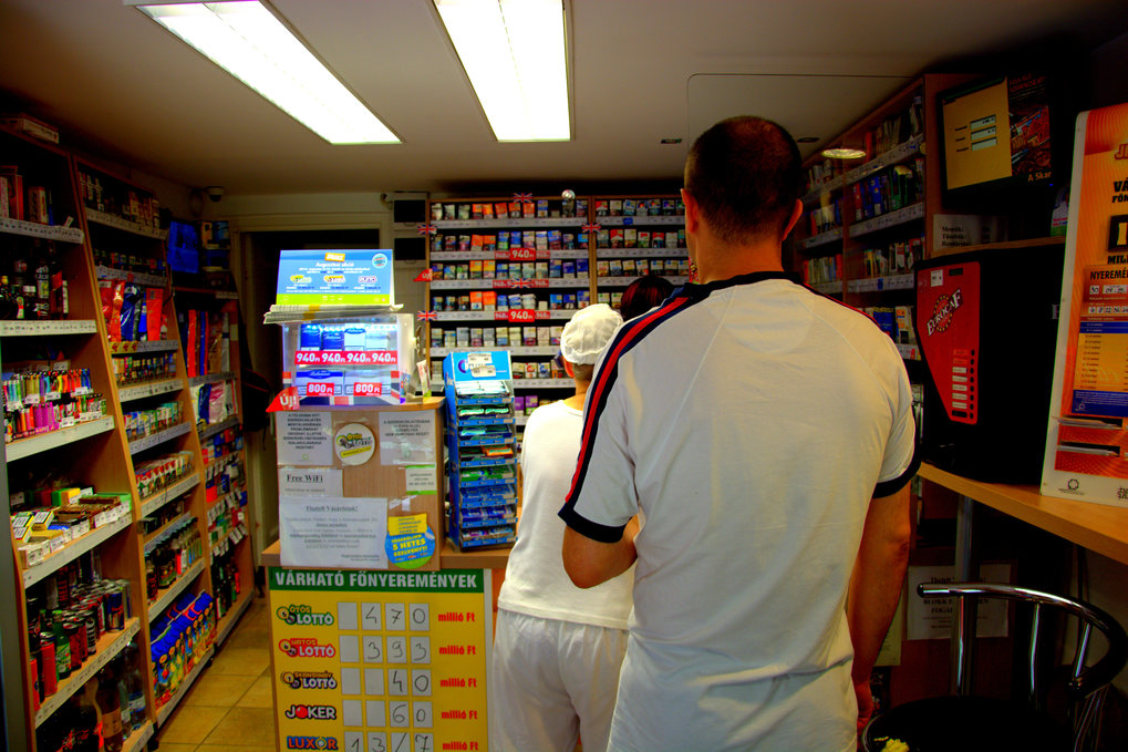 Customers queue up in a National Tobacco Shop.