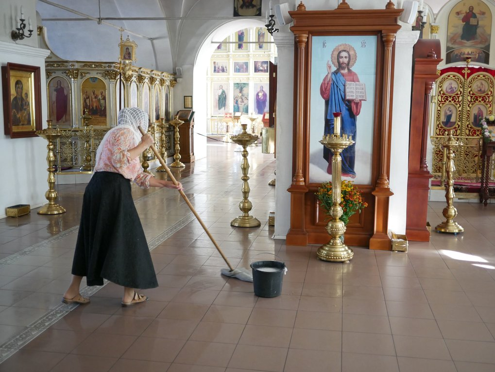Cleaning the church in Holy Trinity St.Sergius Lavra, Russia